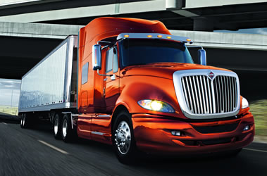"At the Mid-America Trucking Show this week, International® Truck announced new enhancements to its fuel efficiency package —the International® ProStar® ES.  First introduced in December 2014, the ProStar ES, short for efficiency specification, features industry-leading aerodynamics, the most fuel-efficient powertrain/transmission combinations available in the industry and a number of other advanced technologies.  Together, these features enable the ProStar ES to achieve a total fuel economy improvement of 13 percent—and more than 2 percent improvement since its launch late last year.  ""The ProStar ES continues to leverage the latest advancements in powertrain and vehicle technologies to drive incremental gains and provide customers with the industry's best fuel efficiency package,"" said Bill Kozek, president Truck and Parts, Navistar.  The ProStar ES is available both with the Cummins ISX15 and with Navistar's proprietary 13-liter engine (N13). The ProStar ES offers the Eaton-Cummins SmartAdvantage™ powertrain which pairs the Cummins ISX15 with the Eaton Fuller Advantage™ automated manual transmission.  Enhancements to the ProStar ES with ISX15 include the integration of Cummins' ADEPT for the ISX15, which includes SmartTorque2 and SmartCoast. ADEPT is a suite of advanced electronic features for the ISX15 engine that interact with automated manual transmissions, adapting to operating conditions to reduce the variance between newer drivers and experienced experts.  The system continuously makes minor adjustments to speed, power and transmission gear while monitoring current grade and vehicle mass to take advantage of vehicle momentum, maximizing efficiency and using less fuel in the process. Cummins' SmartCoast enables the engine and transmission to work together more effectively to improve efficiency while coasting. On moderate downhill grades, the driveline is disengaged, allowing the engine to return to idle and reducing drag from the powertrain on the vehicle, conserving momentum and improving fuel economy.  Cummins' ADEPT and SmartCoast are also available on non-ES ProStar models powered by the Cummins ISX15. The ProStar ES with Navistar's proprietary 13-liter engine (N13) is available coupled with the Eaton Fuller Advantage™ automated manual transmission.  The ProStar ES with N13 now includes enhanced engine controls, including a ""neutral coast"" feature that shifts the transmission to neutral when a driver backs off the accelerator, maximizing coast time and improving fuel economy.  The newly launched 13-liter engine is one of the lightest, quietest 13-liter engines on the market. With a downsped transmission option, the engine cruising speed drops below 1,100 RPM at 60 miles per hour, a significant reduction compared to traditional engines that operate at 1,250-1,300 RPM at 60 miles per hour. In addition, the engine's steep torque curve, strong structural integrity and low NVH (noise, vibration, harshness) provide for one of the lowest shift points in the industry at 950 RPM.  The ProStar ES, and other ProStar models powered by the ISX15 or the N13 are also available with XFE 75W-90, which is a new and innovative fuel efficient axle lubricant that reduces friction and spin losses, improves durability and drives further fuel efficiency improvements."