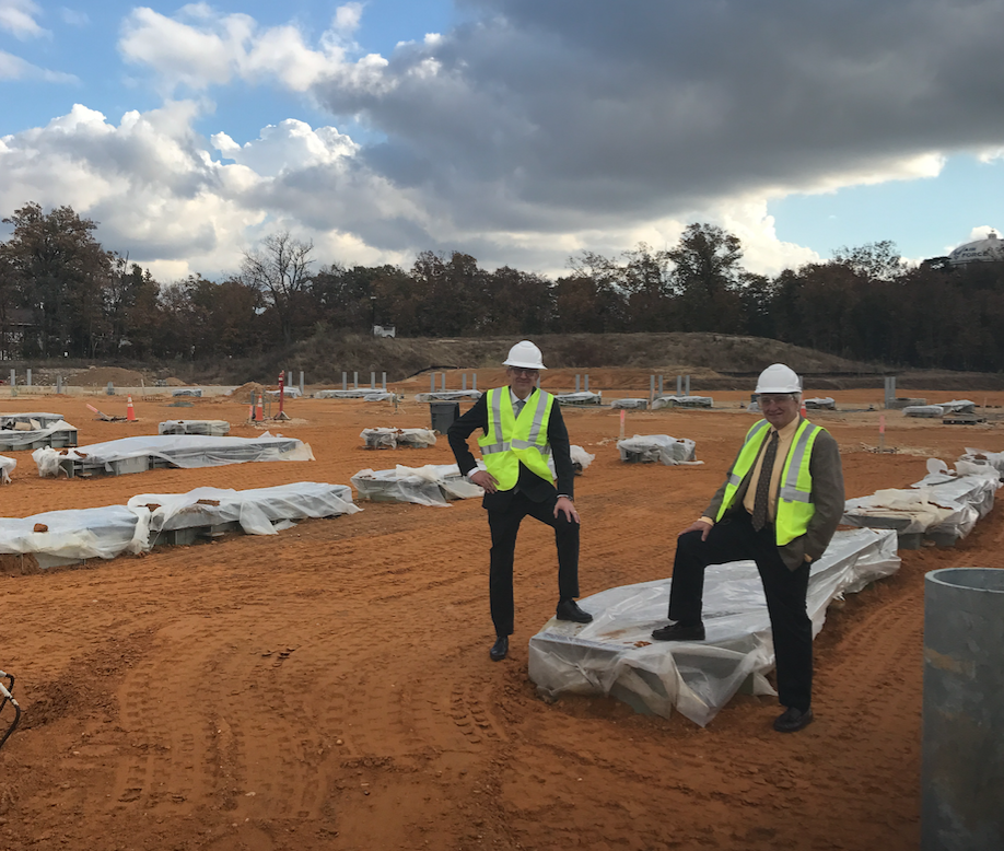 Stertil Group CEO, Ulbe Bijisma (left) and Stertil-Koni USA president, Dr. Jean DellAmore (right) at Washington Metropolitan Area Transit Authority (WMATA) construction site where Stertil-Koni DIAMOND LIFTS are to be installed in new vehicle maintenance facility.