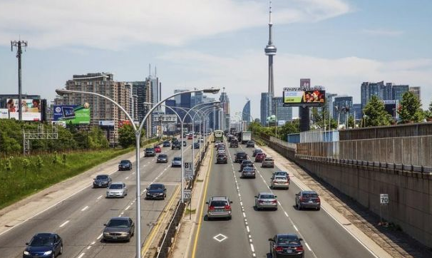 Cars drive in traffic in Toronto