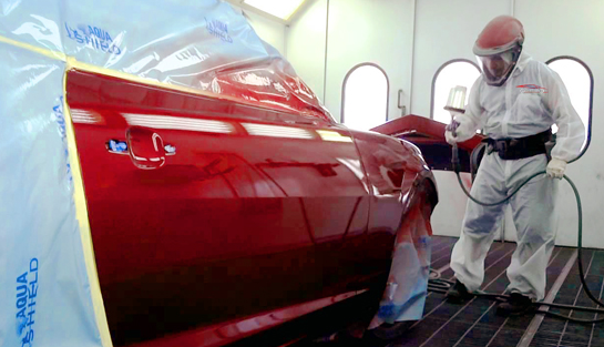 car, in body shop, being painted