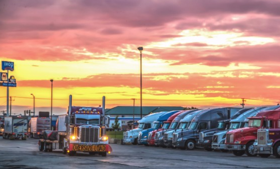 trucks parked, at highway rest stop