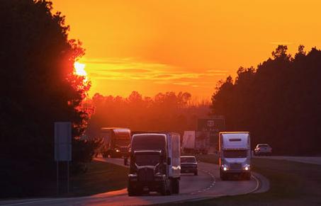 Trucks on Highway at Night