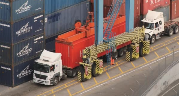 trucks being loaded at port