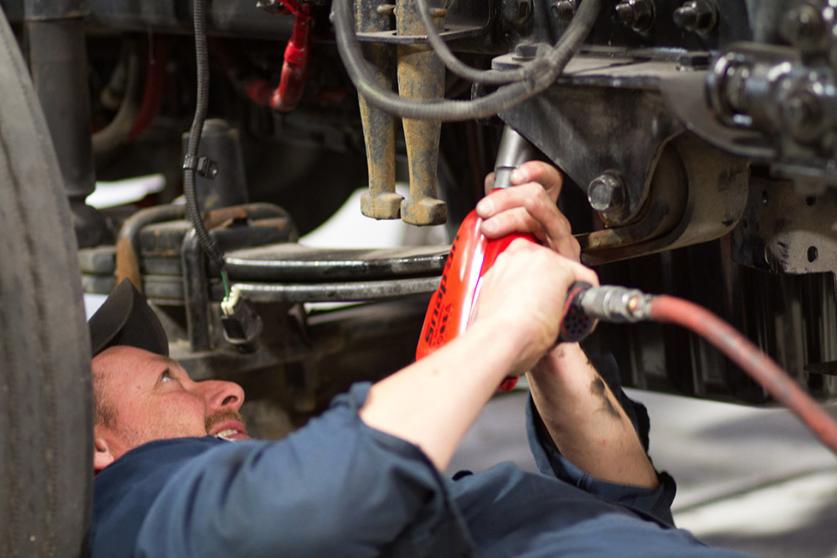 mechanic working on van in a shop