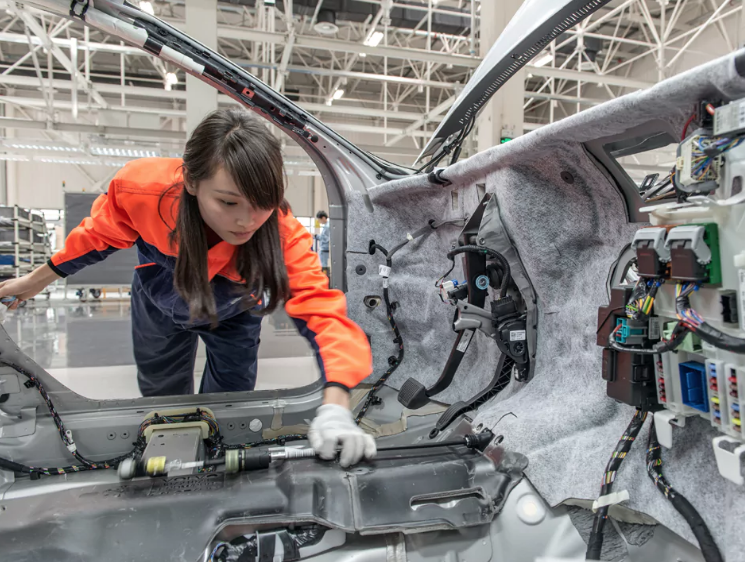 Volvo Group production line with women