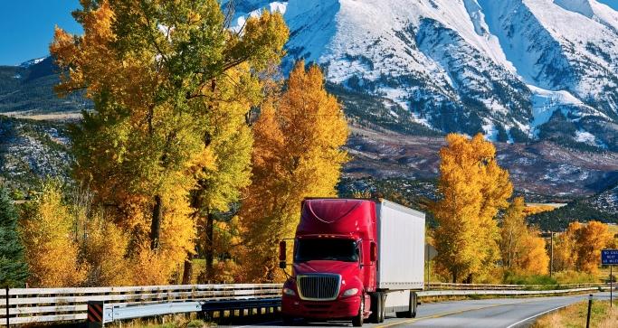 trucks on highway in autumn